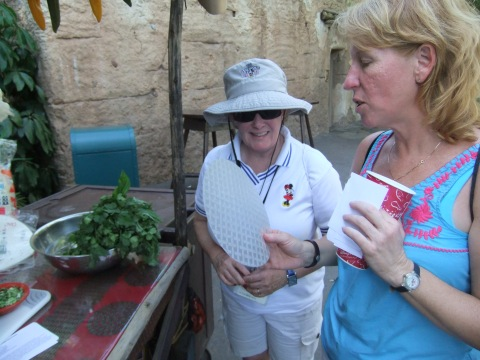 Miss Bonnie explaining the virtues of Rice Paper to Mama Ginny...