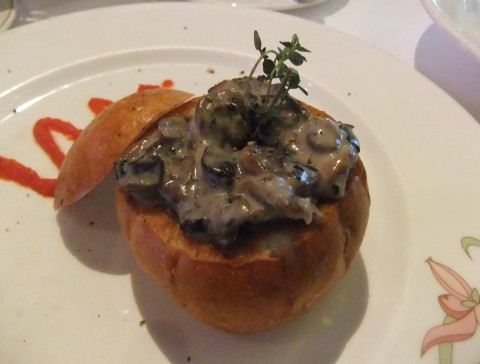 Thyme and Garlic Brioche appetizer from the Enchanted Garden Dinner Menu. Filled with Mushrooms and Leek Stew.