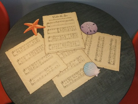 """Sheet Music for """"Under the Sea"""" on table in Little Mermaid room"""