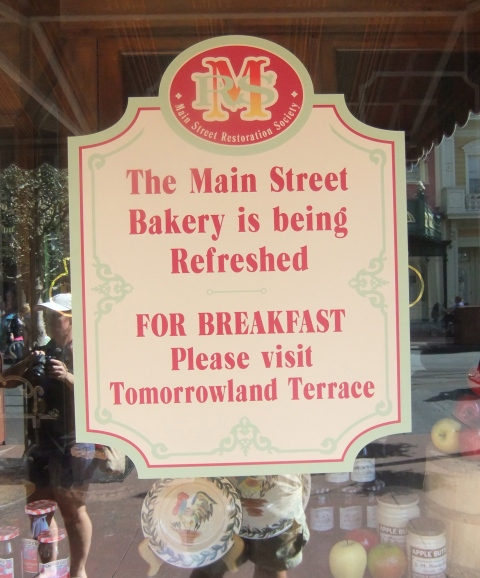 Sign in the window of the shuttered Main Street Bakery