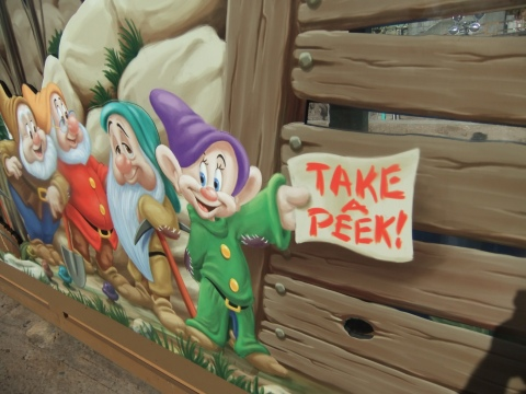 Peephole in the construction wall of the Seven Dwarfs Mine Train ride