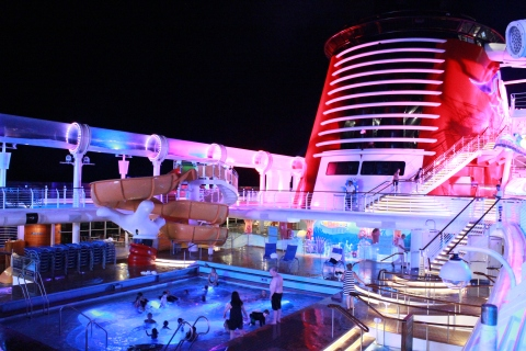 Pool area of the Disney Fantasy at night (photo by Miss Bonnie)