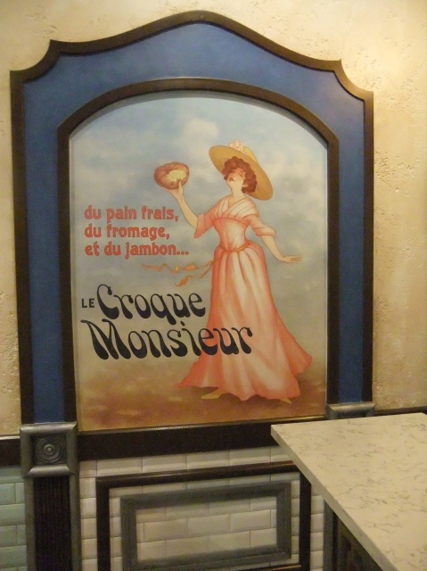 One of the posters on the wall in the seating area of Boulangerie Patisserie
