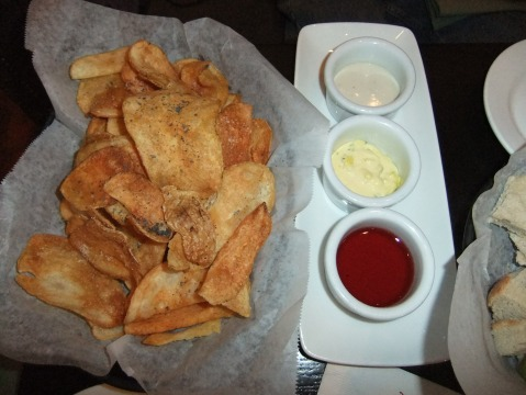 House-made Northwest Chips with a trio of dips: Smokey Blue, Truffle Aioli, and Huckleberry Honey