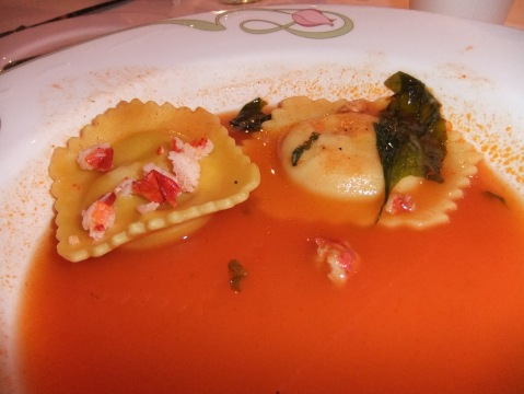 North Atlantic Lobster Ravioli with Roasted Garlic and Sweet Basil in a light Tomato Broth