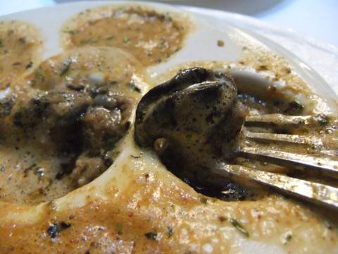 Escargots Gratinés Herb-marinated Snails with Finely Chopped Mushrooms, topped with Garlic Butter and Breadstick