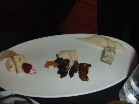 Artisanal Cheeses - Champignon brie, Midnight Moon goat cheese and Flora Nelle blue cheese served with raisins on the vine, pear jelly, spiced pecans, and crostini