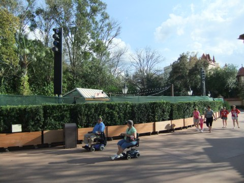 Behind the hedges and scrim is the upcoming home of the Florida Fresh Garden