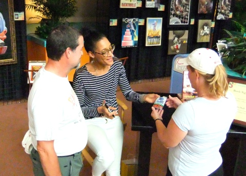 The she's-so-freaking-adorable Carla Hall autographing a Crasins package (don't ask...)