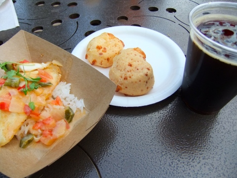 Mocequa de Pescado (Tilapia with Coconut Lime Sauce), Pao de Queijo (Cheese Bread) and a Xingu Black Beer from Brazil